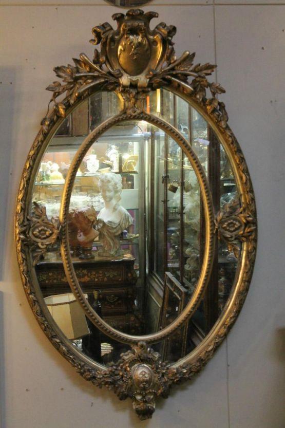 Зеркало в резной позолоченной раме