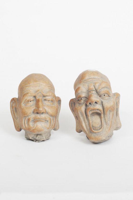 Две головы Будды из камня. Китай, XIX в.