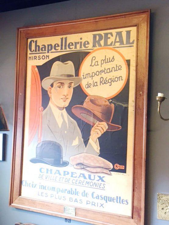 Постер-реклама шляпного магазина