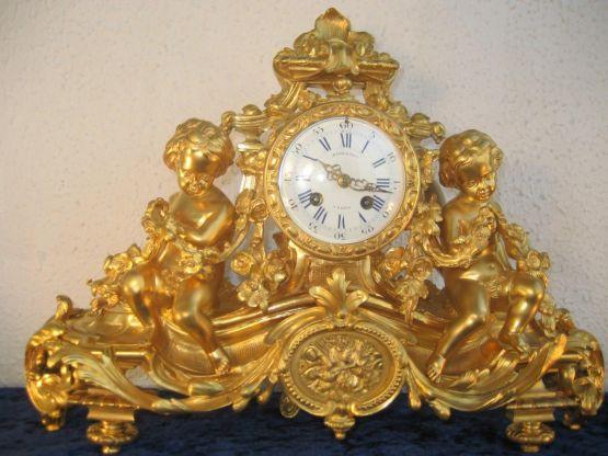 Часы из позолоченной бронзы 'Амуры', XIX в.
